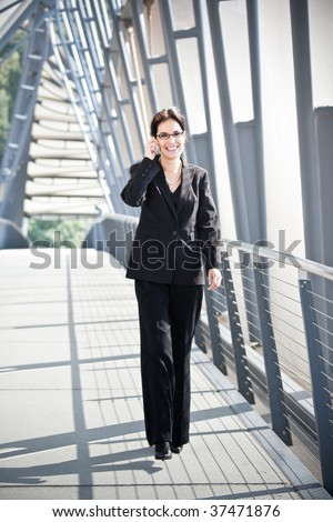 A portrait of a hispanic businesswoman talking on the phone