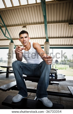 A portrait of a hispanic skaterboarder outdoor - stock photo
