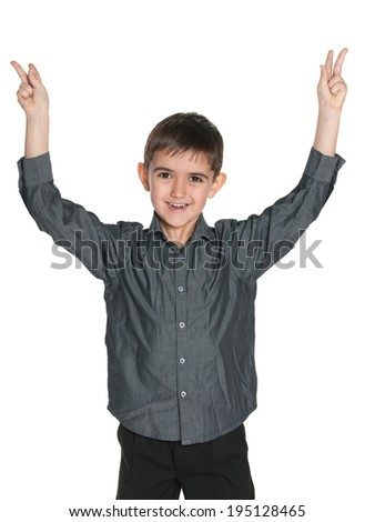 A portrait of a joyful young boy on the white background - stock photo