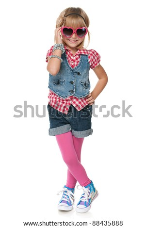 A portrait of a laughing fashion little girl; isolated on the white background - stock photo