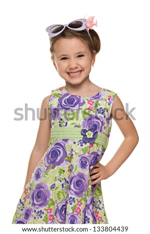 A portrait of a laughing little girl looks forward; isolated on the white background - stock photo