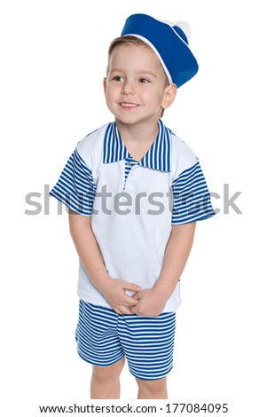 A portrait of a little boy in a sailor suit looking aside on the white background