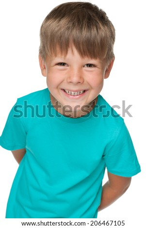 A portrait of a little happy boy in a blue shirt on the white background - stock photo