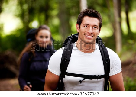 A portrait of a male hiking in the forest with a female - stock photo