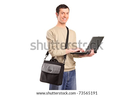 A portrait of a male student with a shoulder bag working on a laptop isolated on white background - stock photo