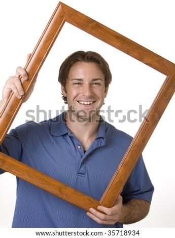 A portrait of a man holding a frame around his head - stock photo