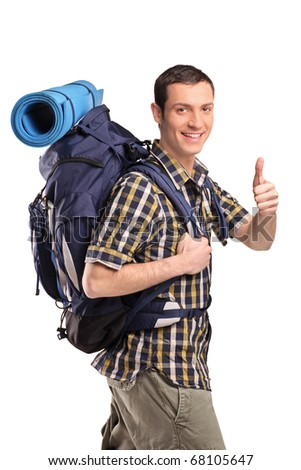 A portrait of a man in sportswear with backpack giving thumb up isolated on white background
