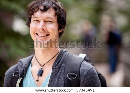 A portrait of a man outdoor on a hike