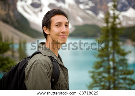 A portrait of a man outdoors on a hiking trip - stock photo