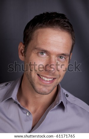 A portrait of a man smiling. - stock photo