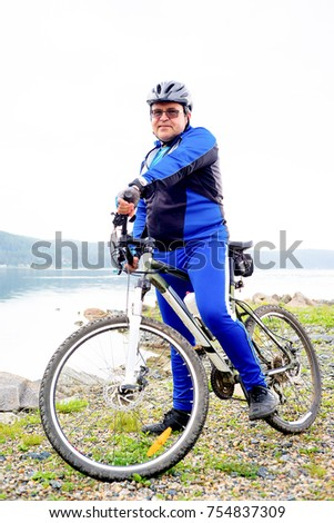A portrait of a man travelling on a bicycle