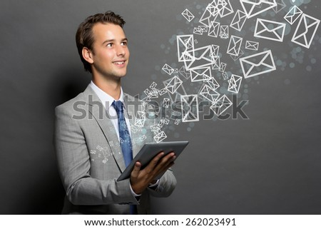 a portrait of a man who using a tablet for internet access - stock photo