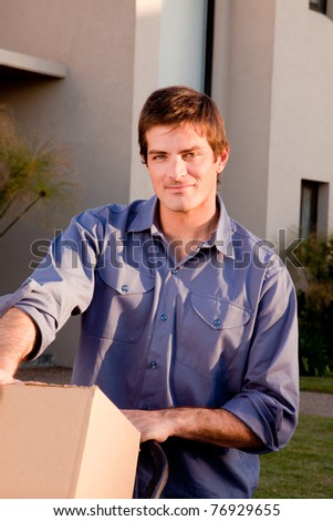 A portrait of a man with moving boxes on a trolly - stock photo