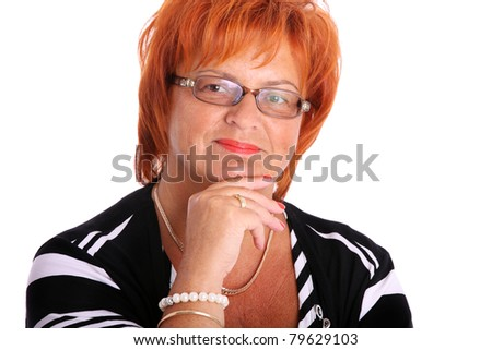 A portrait of a mature businesswoman smiling over white background - stock photo