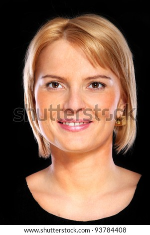 A portrait of a mature elegant woman smiling over black background - stock photo