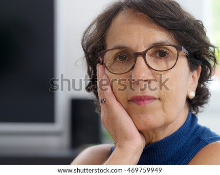 a portrait of a mature woman with glasses
