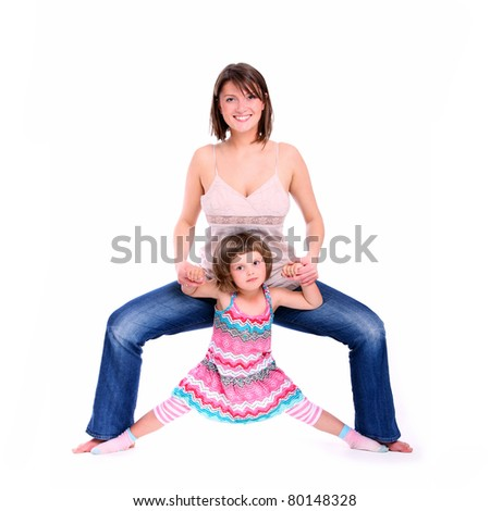 A portrait of a mother and her baby girl doing splits over white background - stock photo