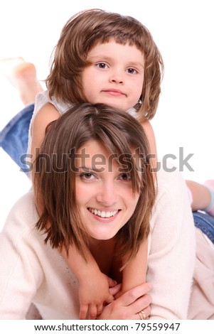 A portrait of a mother and her baby girl lying on the floor and smiling over white background - stock photo