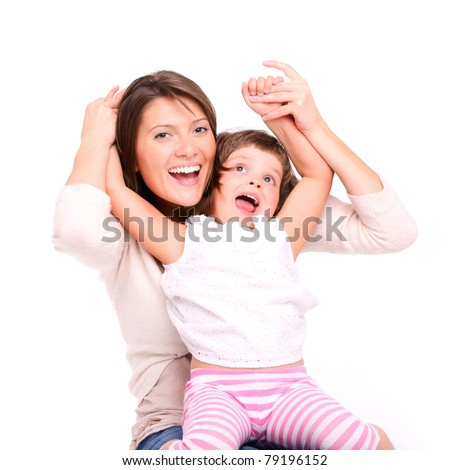 A portrait of a mother and her baby girl playing and smiling over white background - stock photo