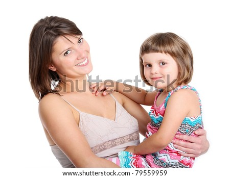 A portrait of a mother and her baby girl smiling over white background - stock photo