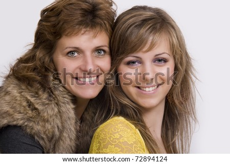 A portrait of a mother and her daughter - stock photo