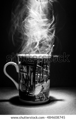 A portrait of a mug with smoke inside