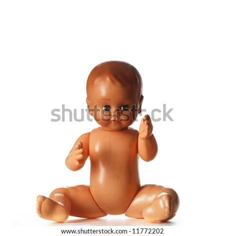 A portrait of a plastic sitting child isolated on white
