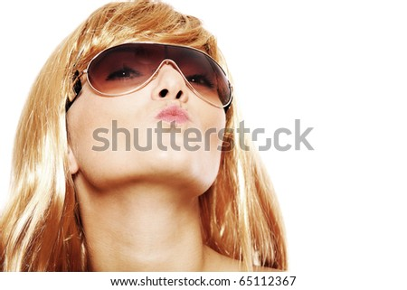 A portrait of a pretty blond woman sending a kiss over white background - stock photo