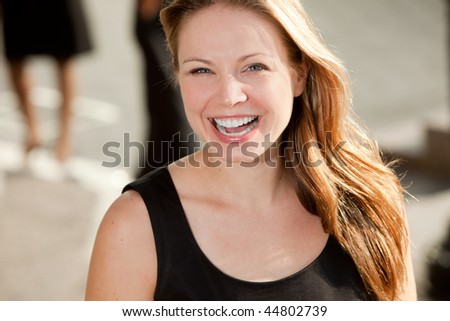 A portrait of a pretty blond woman with black dress - stock photo