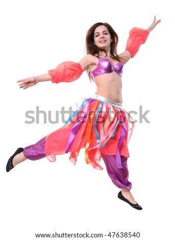A portrait of a pretty girl dancing in a fancy costume - stock photo