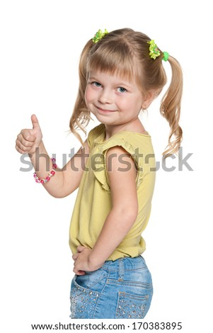 A portrait of a pretty smiling little girl holding her thumb up - stock photo