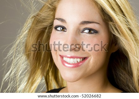 a portrait of a real beautiful young surprised girl