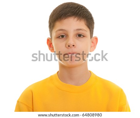 A portrait of a sad handsome boy with gritted lips; isolated on the white background - stock photo