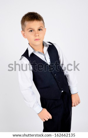 A portrait of a school boy in school uniform a black and white s