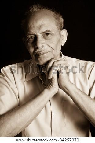 A portrait of a senior Indian man - stock photo