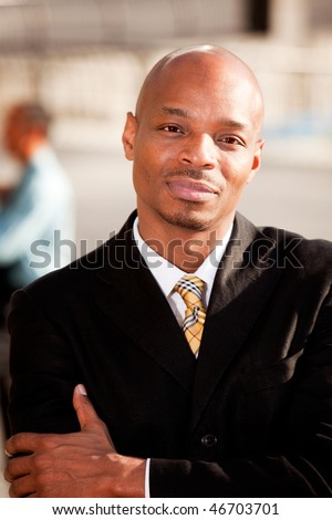 A portrait of a serious African American Business Man - stock photo