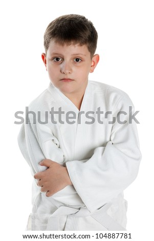 A portrait of a serious boy in kimono; isolated on the white background