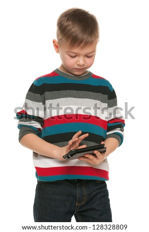 A portrait of a serious boy with a smartphone - stock photo