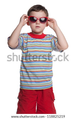 A portrait of a serious little boy with sunglasses; isolated on the white background