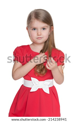 A portrait of a serious preschool girl against the white background