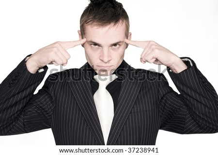 A portrait of a serious young professional pressing he's index fingers against he's forehead - stock photo