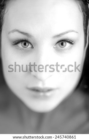 A portrait of a sexy young model with perfect skin and glamour makeup. soft focus - stock photo