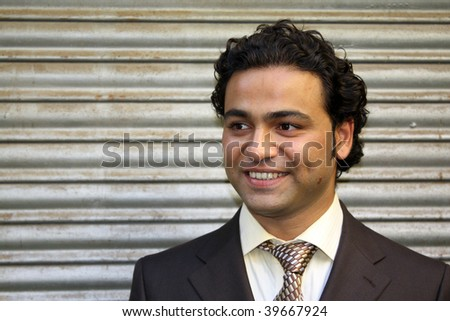 A portrait of a smart Indian business executive. - stock photo