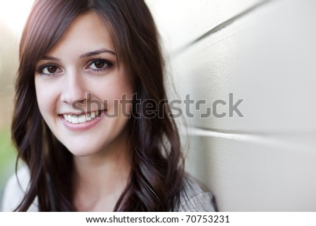 A portrait of a smiling beautiful woman - stock photo