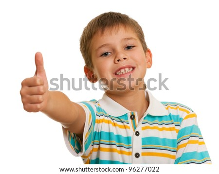 A portrait of a smiling boy holding his thumb up; isolated on the white background - stock photo