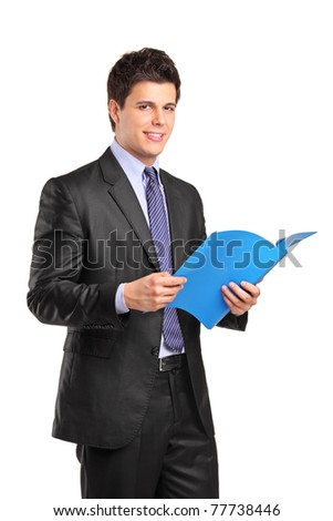 A portrait of a smiling businessman holding a fascicule with documents isolated on white background - stock photo