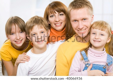 A portrait of a smiling family of five - stock photo
