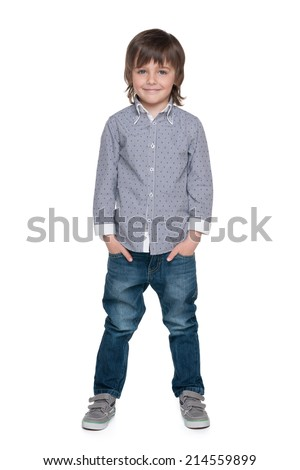 A portrait of a smiling fashion little boy against the white background - stock photo