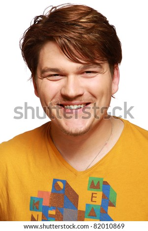 A portrait of a smiling happy man, isolated on white background - stock photo