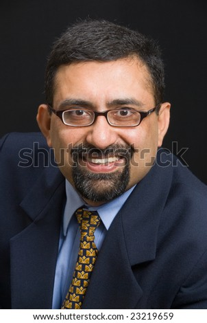 A portrait of a smiling Indian executive